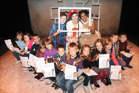 Visiting children from Chernobyl  meet the cast of Rupunzel at York Theatre Royal, back from left,  Max Gallagher, Gayle Newbout and Selina Zaza