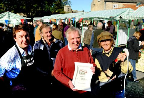 Hovingham market traders  celebrate their latest award. Pictured from left, Pete Stark, Richard Wood, Phil Chapman and Mark Woollley