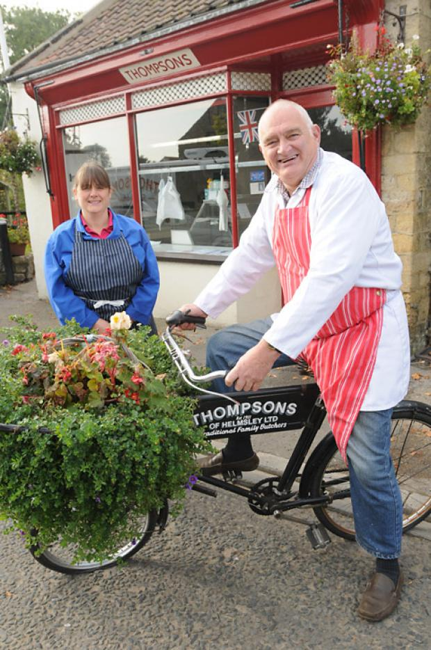 Brian Thompson  is retiring from Thompson's Butchers in Helmsley, pictured with daughter Hazel Morrison