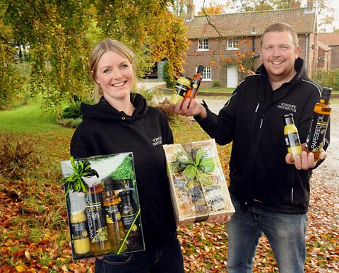 Jennie and Adam Palmer with some of their award winning Yorkshire Rapeseed Oil products at their farm