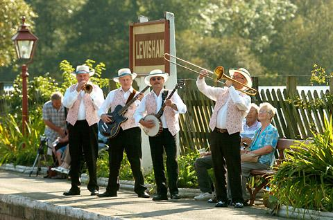 Ron Burnett and fellow musicians in action at Levisham Station during a steam gala