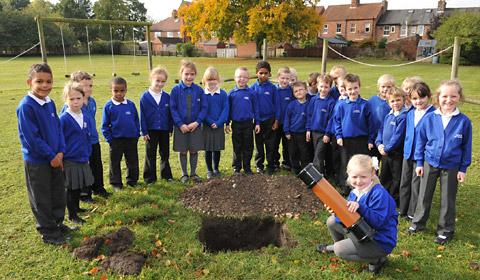 Youngsters at Norton Primary School bury the time capsule they have created