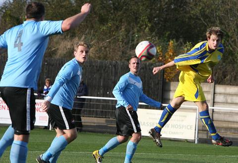 Pickering Town's  Tom Clark beats the Worksop defence  but heads wide of  the goal