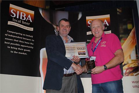 Tom Mellor receives his Bottled Gold Beers award at the SIBA North Region awards