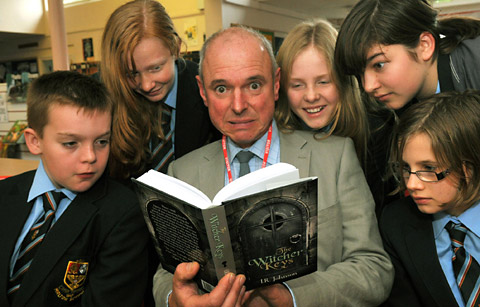 Author Ian Johnson reads a passage from his new book The Witcher Keys to pupils at Malton School. Inset – the cover of the book