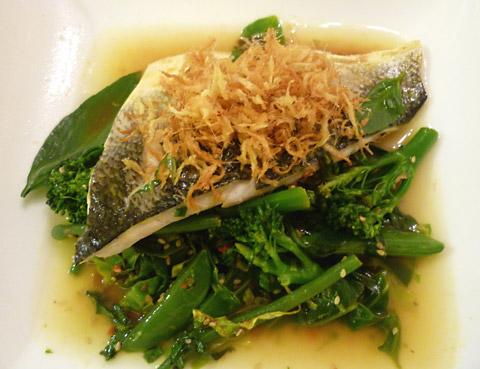 Gingery steamed sea bass with crispy ginger and a fragrant, spicy broth