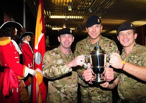 Corporal Robbie Harmer, Lance Corporal Nick Webb and Captain Adam Crookshank with the Race To The Pole trophy at the Dragoon Guards Regimental Museum