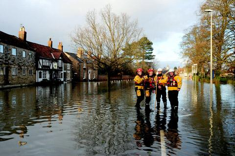 Firemen in Old Malton take a breather from pumping out the floodwater