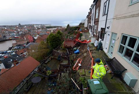 The row of cottages high above Whitby harbour which face demolition after the landslide