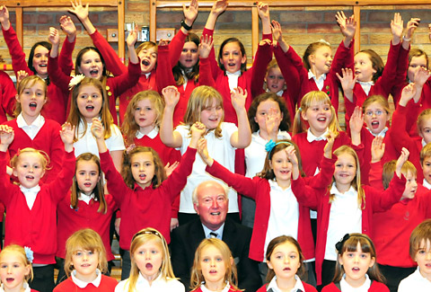 Peter Lawrence sings along with pupils at Headlands Primary School, York