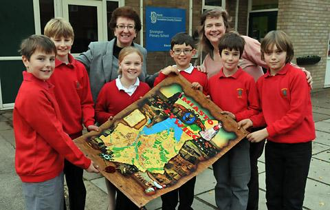 Headteacher Jill Wells and teacher Sara Paxton with pupils at Sinnington Primary School and a souvenir from a trip to Poland