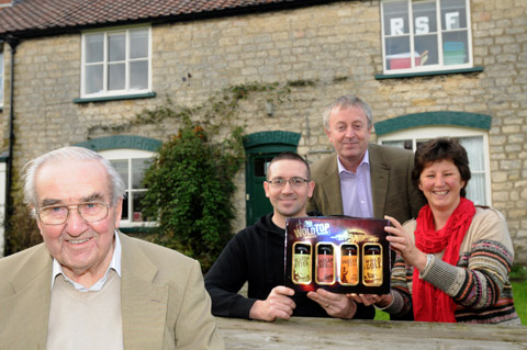 Gill Mellor, right, director of Wolds Brewery, hands over some beer to Neil Burgess,  second left, who raised the most sponsorship by an individual, watched by Lawrence Thackray, left,  of Old Malton, and Rob Davies from Ryedale Special Families