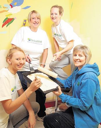 Lisa Keenan, right, from Ryedale Special Families, is helped by Charis-Anne Wilkie-Metterson, Anita Newbould and Lisa Earnshaw from Yorkshire Building Society during the makeover