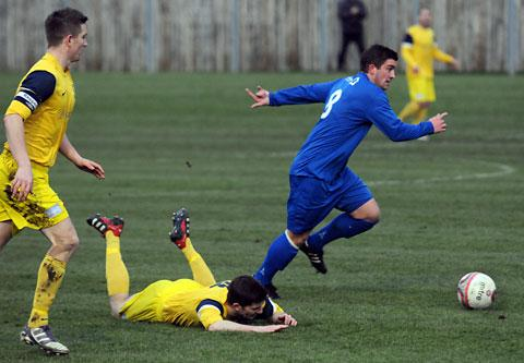 e487a7fb7f65 Pickering s John Heads leaves an opponent grounded during the Pikes  derby  win over Tadcaster Albion
