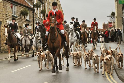 The Middleton Hunt leaves Malton Market Place on its way around the town