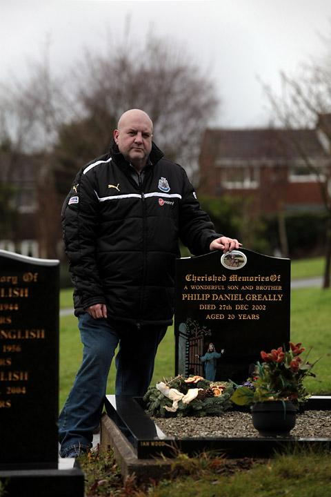 Colin Greally at the grave of his son, jockey Philip. Philip's parents are now fundraising in his memory. Picture: Lewis Arnold