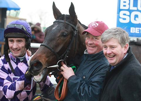 John Quinn, right, with rider Dougie Costello, left, travelling head-lad Graham Gray and Cockney Sparrow after their Doncaster win