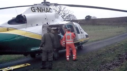 One of the two men being taken to hospital by Air Ambulance following a bridge collapse in a North Yorkshire village.
