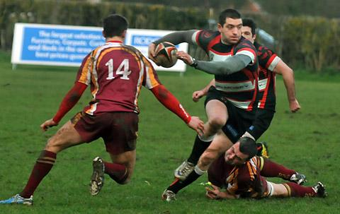 Malton & Norton centre Ryan Lonsdale evades a posse of tacklers to score the opening try