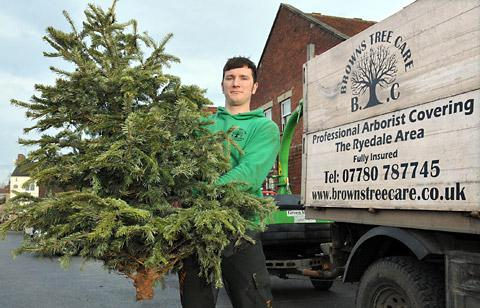 James Brown with one of the Christmas trees given by a member of the public to be shredded at Coopers car park, Pickering, to help raise money for Yorkshire Air Ambulance