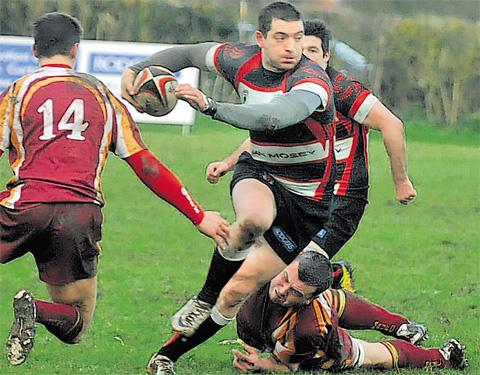 Ryan Lonsdale evades a posse of defenders to score Malton & Norton's first try against Middlesbrough