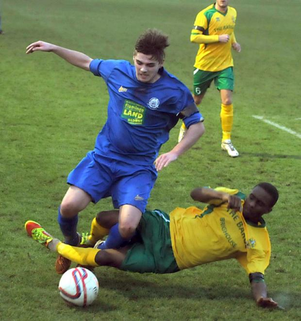Pickering Town's Lewis Taylor is fouled by Brighouse defender Leon Henry
