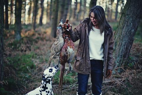 Nicola Dixon with her Dalmation Potter and a brace of pheasants she shot in North Yorkshire