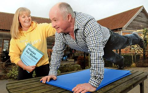 Karl Avison and instructor Wendy Harding promote the Pilates for Blokes course at the Cedarbarn Farm Shop, Pickering
