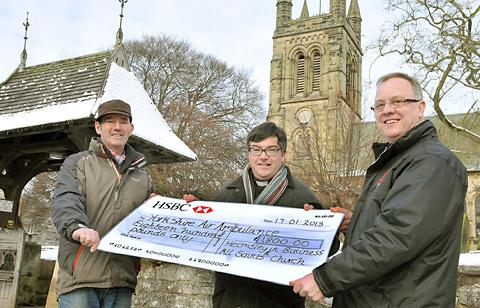David Hebden, right, receives a cheque for £1,800 for