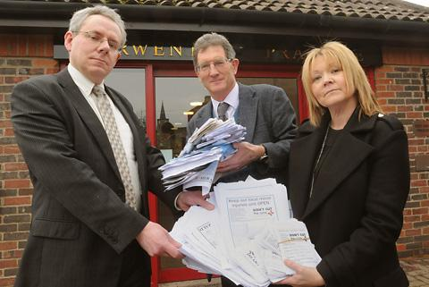 Simon Cox, left, receives the Malton Hospital petition from Dr Michael Lynch and Coun Lindsay Burr outside the Derwent Surgery in Malton