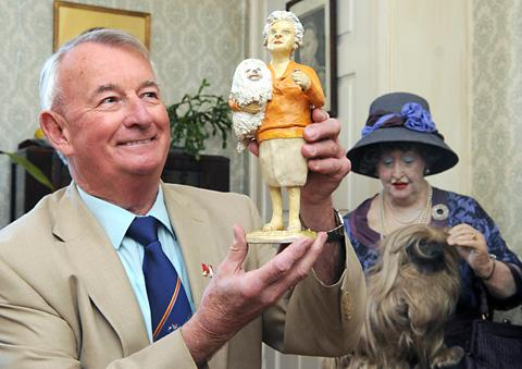 Gazette & Herald: Ian Ashton, from the World of James Herriot, with a figure of Mrs Pumphrey and Tricky Woo from the memorabilia collection, in front of the Mrs Pumphrey mannequin at the museum in Thirsk