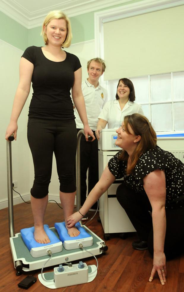 At The Clinic at Newbiggin, Malton, are chiropodist Carly Bodill, right, using the Sidas machine which takes moulds of the feet to produce insoles for client Imogen Defty. Looking on are physiotherapist Euan Campbell and reflexologist Paula Koeppen