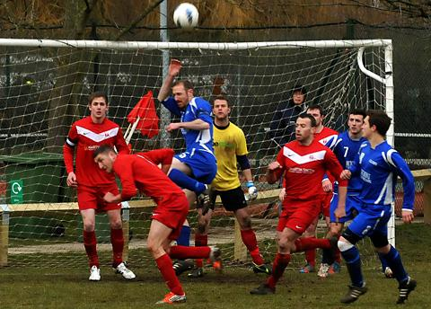 Terrington Glory's Andy Park attacks the Copmanthorpe goal