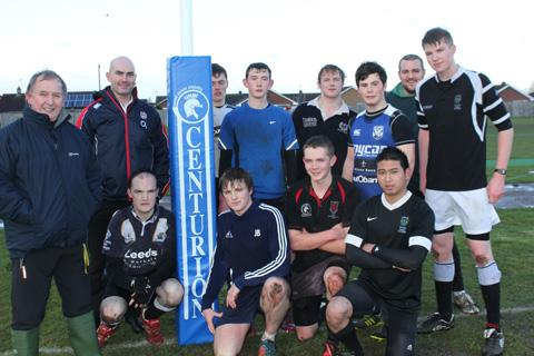 James McKay, second from left, RFU rugby development officer, opens the new rugby pitch at Norton College helped by players and staff from the Sixth Form Rugby Academy