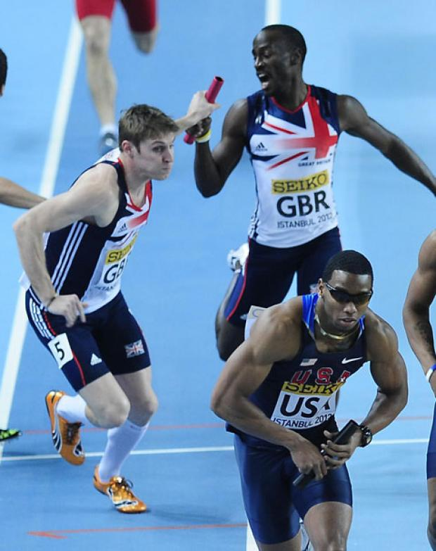 Richard Buck accepts the baton en route to winning the 4x400 metres relay silver medal during last year's world indoor championships in Turkey