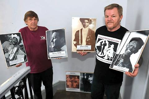 John Adamson and Glyn Roberts with some of the images being shown as part of an exhibition during this weekend's Cajun Festival at the Milton Rooms, Malton