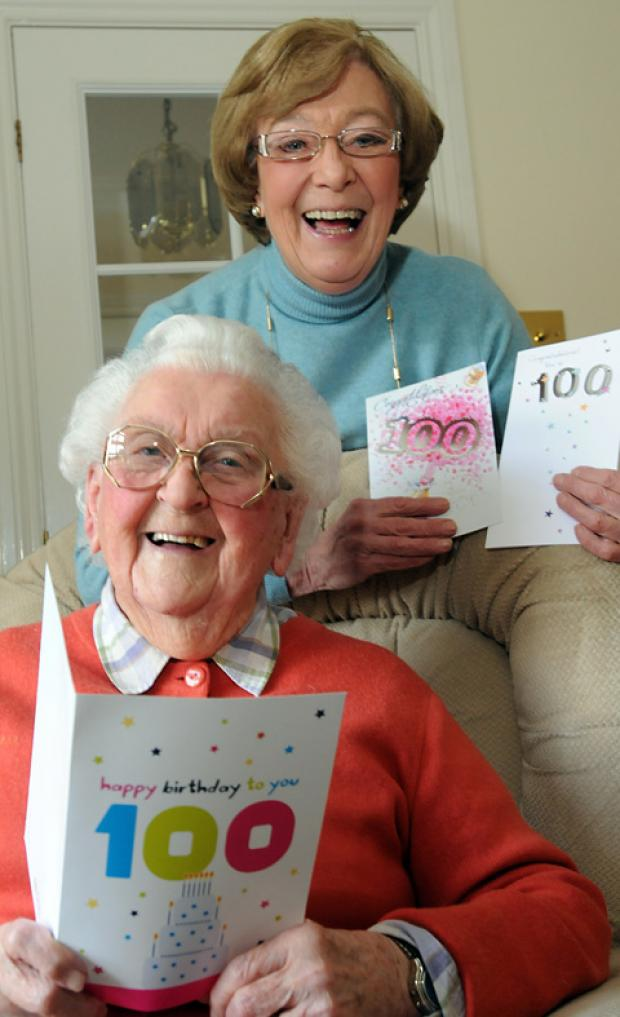 Pat Kew celebrates her 100th birthday with her daughter, Judy