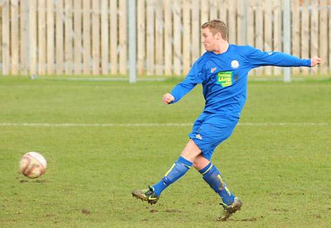 Top scorer Liam Salt fires in the first of his hat-trick for Pickering against  Barton Town