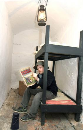 Phillip Sidebotham, ten, in the recreation of a Second World War air raid shelter at the World Of James Herriot. Picture: Richard Doughty