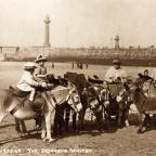 Donkeys and their riders on the beach at Whitby, a picture from 1925