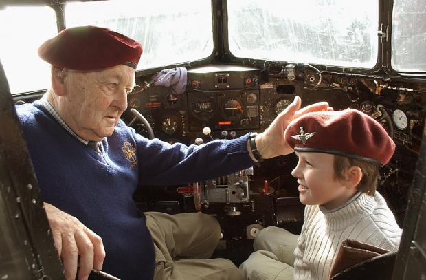 Gazette & Herald: Des Reed with his grandson Thomas, in 2005, then aged 10, in the cockpit of the Douglas DC3 Dakota at the Yorkshire Air Museum, Elvington, during the events to mark the 60th aniversary of Operation Varsity