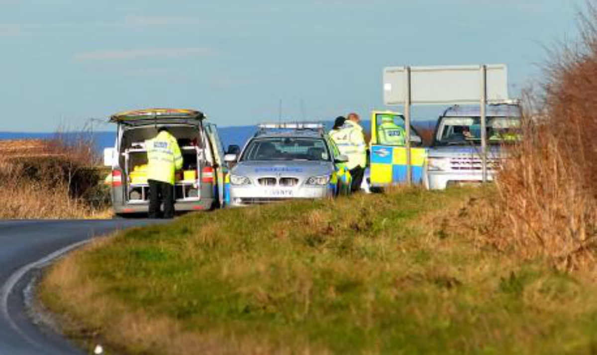 Police at the scene of the crash on the B1248 near Wharram-le-Street last year in which three people were killed