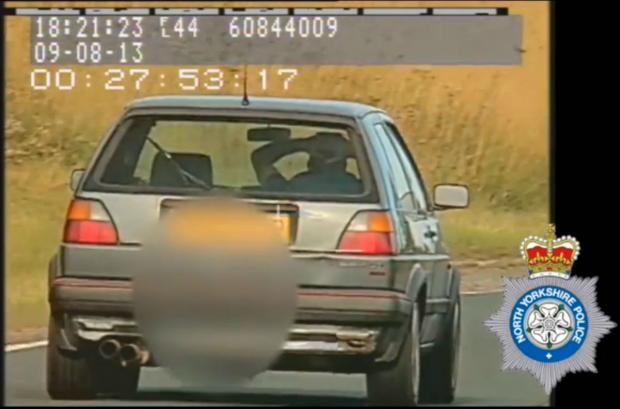 Gazette & Herald: Motorist banned after caught driving with hands on head