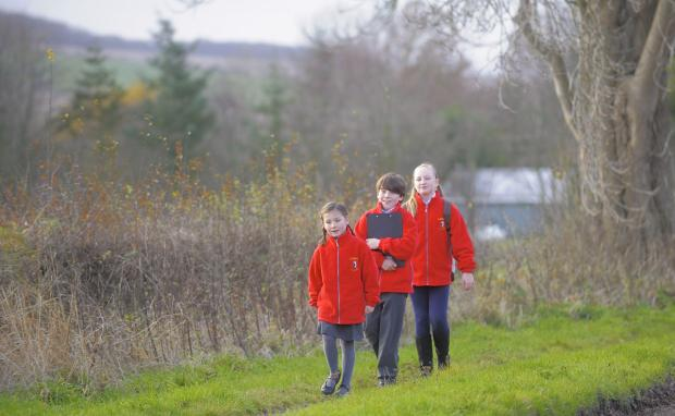 Gazette & Herald: Jess, five, Tom, nine, and Serena, 11, of Luttons Primary School, explore the Great Wold Valley Heritage Trail