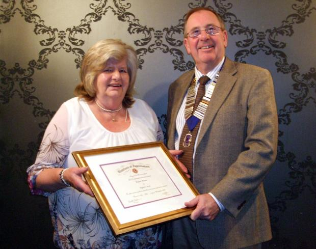 Daphne Bowes receives the Lions Club's Certificate of Appreciation from president Vic Hall