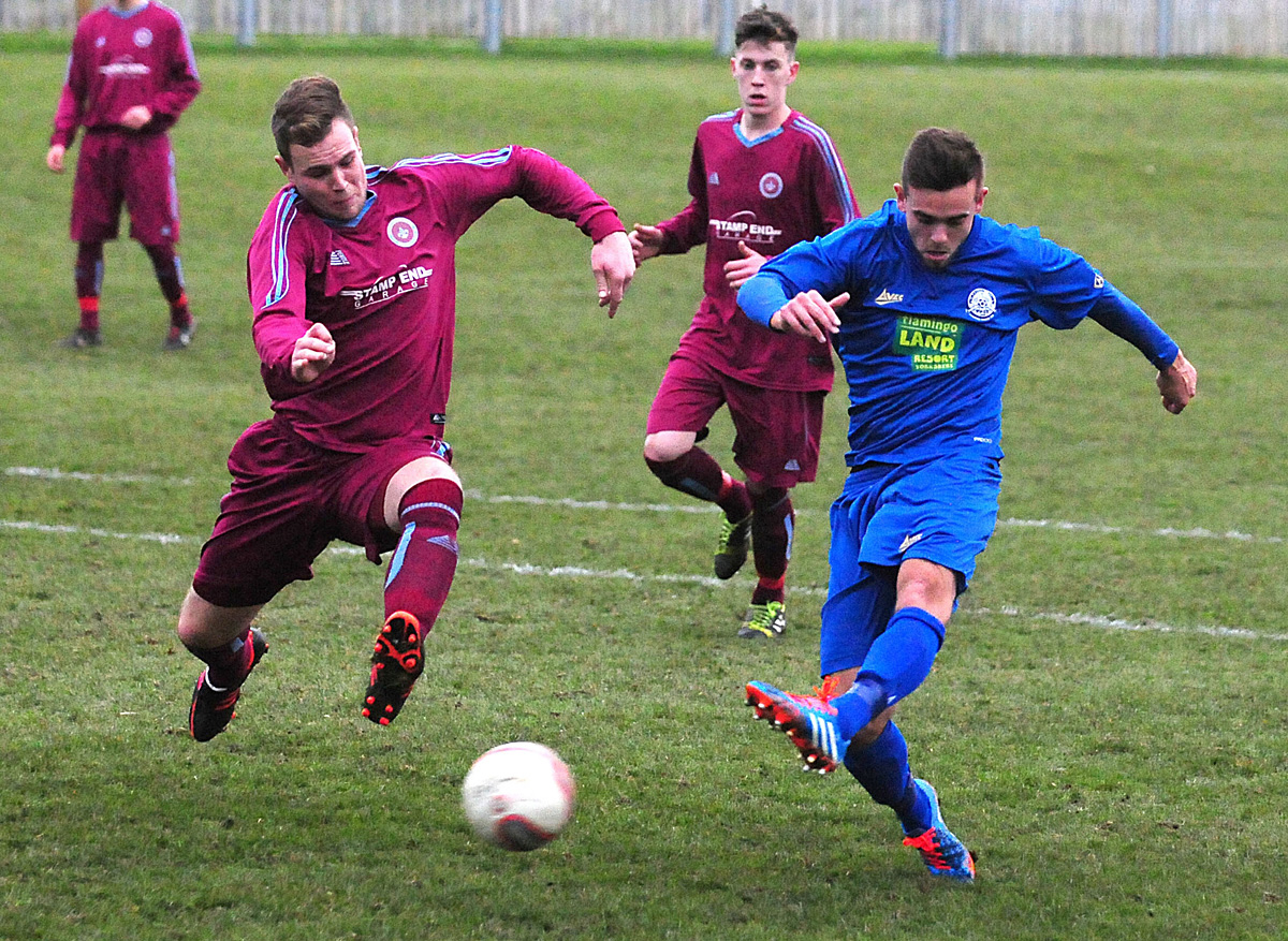 In-form Pickering Town striker Joe Danby shoots and scores for Pickering Town – one of 25 league and cup goals this term