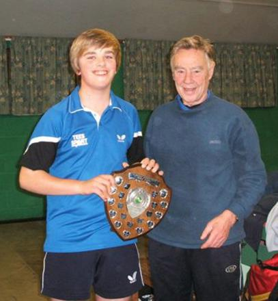 James Rule, left, receives his trophy from John Gascoyne