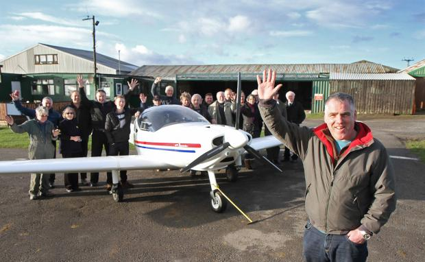 Manager Steve Hoyle and supporters celebrate the decision on the future of Bagby Airfield, near Thirsk