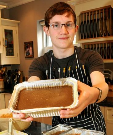 Callum Young with one of his sticky toffee puddings Picture by Garry Atkinson