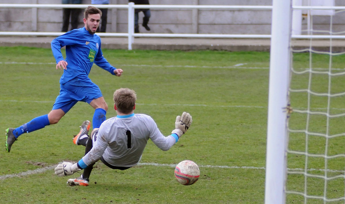 Pickering Town's Joe Danby slots the ball into the Retford net for the Pikes' first goal of their 2-1 win